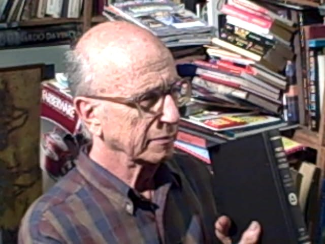 Eli Goodman with Price Guide to the Occult. Photo by Arnold Herr