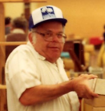 Garvin packing up books at 1980s Book Fair